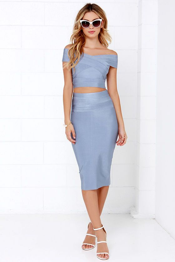 "The Some Like it Bardot Blue Grey Two-Piece Dress will have you feeling like a modern day Bridgette Bardot! Thick stretch knit creates a sexy bandaged look while forming a crisscrossing, off-the-shoulder neckline atop the body-hugging cropped bodice. A matching pencil skirt starts at a banded high waist and extends to chic midi length. Top has gold back zipper. Skirt has hidden back zipper with clasp. Unlined. Small top measures 11"" long. Small bottom measures 25.5"" long. 90% Polyester, 10%…"