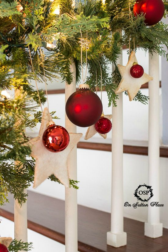 A Pop of Red for Christmas | Stairway decorated with greenery, red ball ornaments and cute felt stars | Easy ideas for adding Red to your decor that are budget-friendly and fun. Lots of examples and suggestions for any style. #Sponsored