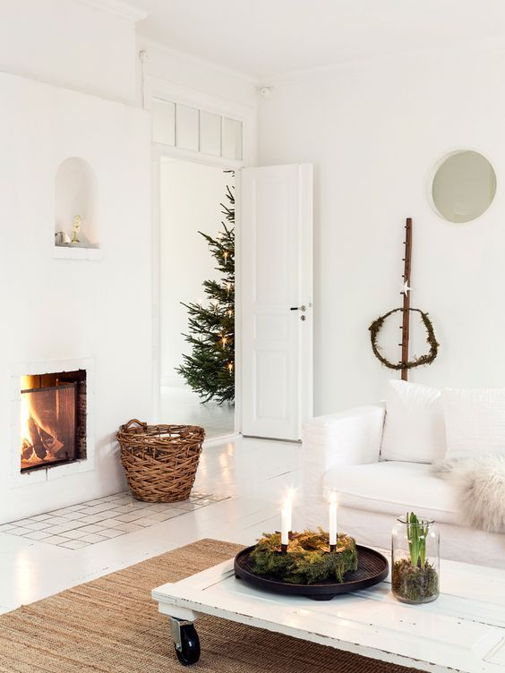 This is such a perfect, simple white room! I love the all white look, but it works especially well with bits of green and natural touches like the wicker basket.