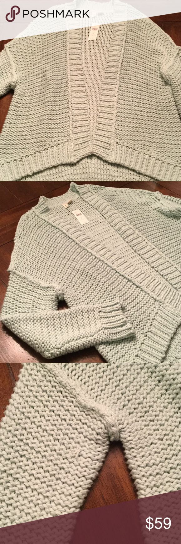 Anthropologie Cardigan This cardigan is perfect for cool spring night bon fires 🔥 Mint green color that is more like stock photos than my photos. So soft and cozy! Could be worn over sized for small or medium ladies also. Please note there are some rough ends as this is a knitted sweater. Anthropologie Sweaters Cardigans