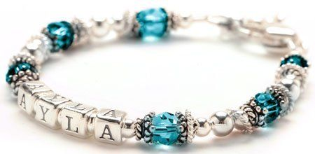 "Personalized Baby Bracelet- Sterling Silver & December Birthstone Crystal Lily Brooke Jewelry. $44.00. Ships in signature Lily Brooke Jewelry box. Comes with heart shaped lobster claw clasp and 1"" of Growth chain. Blue Topaz crystal color represents December birthstone.. Sterling silver & Blue Topaz crystals create a beautiful child's name bracelet.. Handmade in newborn through teen sizes. Lily Brooke designer will contact you via email to request name spelling and size."