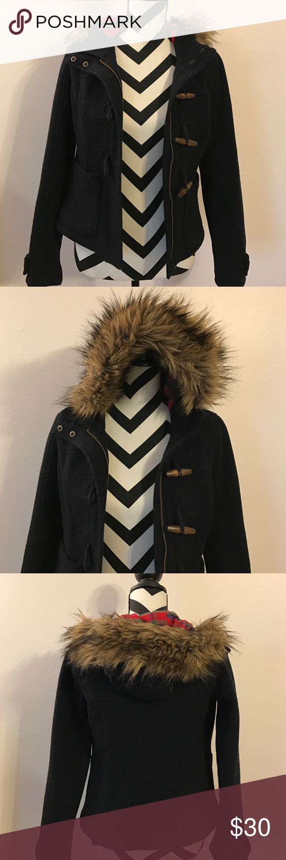 Hollister coat Navy coat with wooden buttons and a zipper. Plaid lining big the inside of the hood and fur on the outside. This coat is super cute and in great condition! Hollister Jackets & Coats Pea Coats