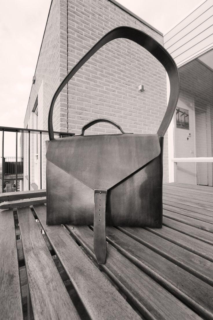 Elegant handmade handstitched women's leather bag.