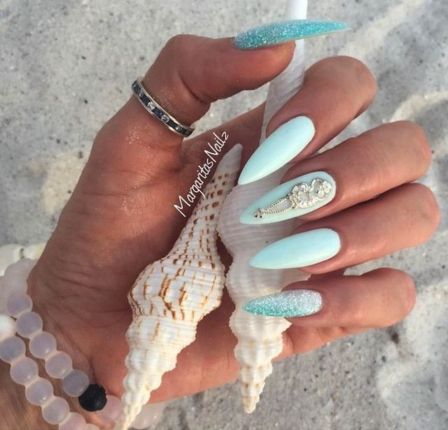 """Stiletto nails have been clawing its way to the top of the beauty pyramid. Check out 10 """"something blue"""" stiletto nail designs we love."""
