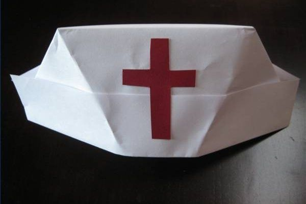 Being able to fold a nurse's hat is a quick way to create a Halloween or work party costume.  All it takes is some paper and a few basic steps.