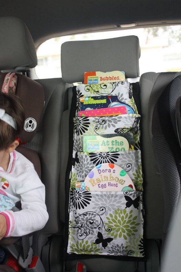 You can make some cloth bags, and then attach them on the back of the seat in your car as a book holder for your passengers' reading. http://hative.com/storage-organization-ideas-for-your-car/