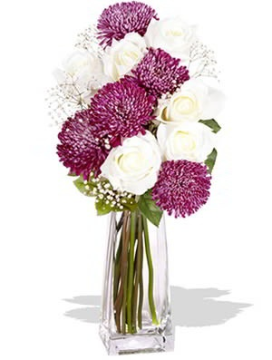 Charming    This simple yet elegant bouquet is everything its name suggests - Charming. Prepared using gorgeous premium Roses and unique Disbud Chrysanthemums, this is sure to charm the pants of that special someone!