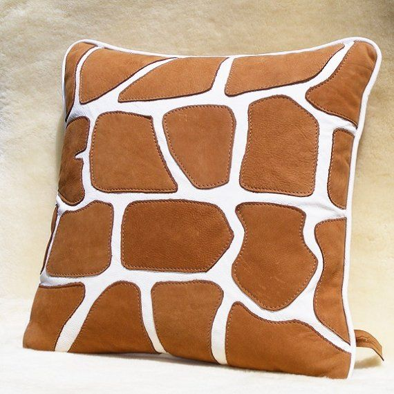"18"" appliqued leather giraffe pillow $90"