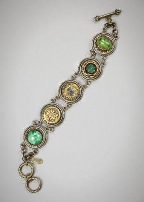 Mahalia bracelet:  Vintage German glass cabochons, one antique brass button circa 1880-1900, new Czech glass button, and a Swarovski palace green opal crystal.