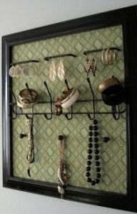 DIY Jewelry Storage-- vintage or cheap frame with fabric pushpin board. use smaller photo frames for earrings.