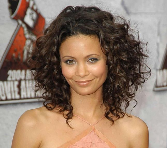 Have curly hair? Put lots of layers in your mid-length cut to keep the volume on top.