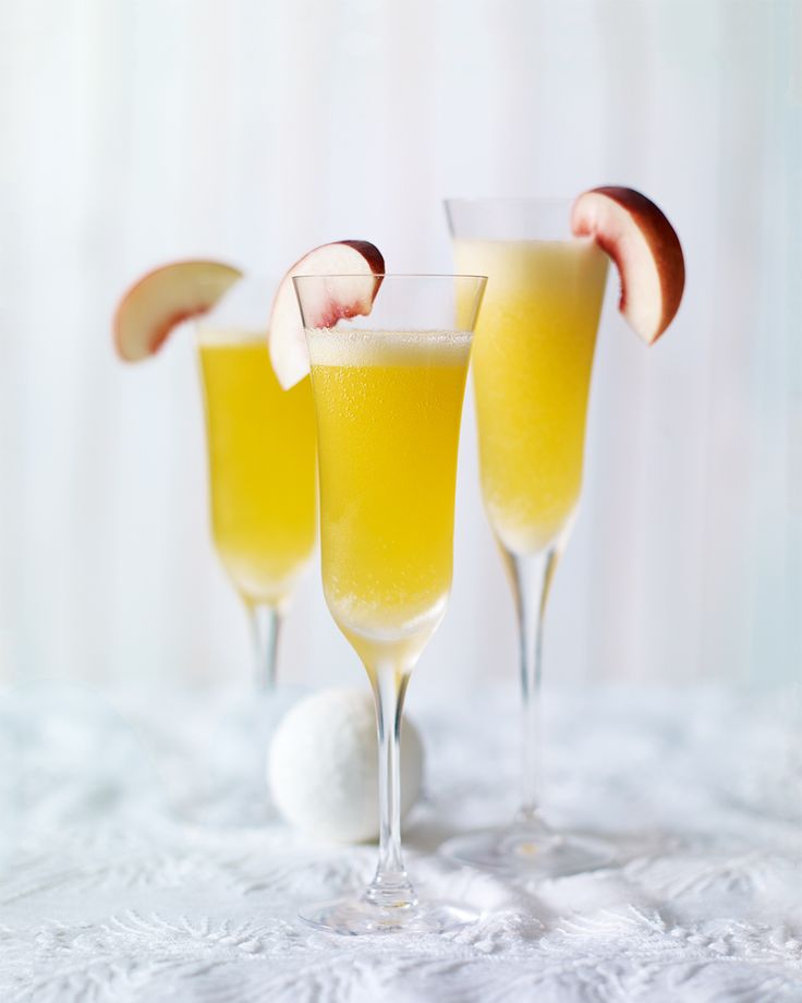 A twist on the classic bellini, this peach and passion fruit cocktail makes an elegant alternative to champagne for Christmas or New Years Eve celebrations.