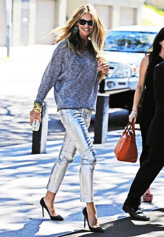OMG Elle Macpherson...way to go... you're totally wearing my current dream outfit (cozy knit sweater, metallic pants and Louboutin studded heels, not to mention the subtle yet fabulous accessories)