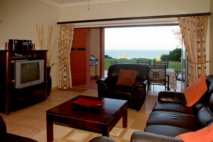 Dark furniture in this ground floor holiday apartment with the sea in the background. A lovely calming effect for a great holiday.