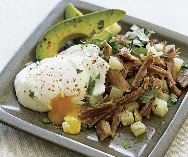 Pork and Potato Hash with Poached Eggs and Avocado recipe. In this rich dish, poached eggs aren't just for breakfast anymore. For a finishing touch, sprinkle the hash with cilantro and piment d'Espelette.