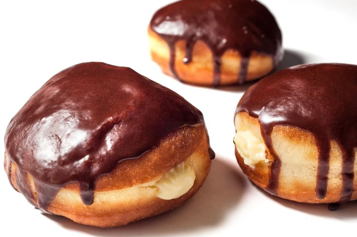 A delicious recipe for Boston cream donuts: basic yeast donuts filled with vanilla custard and glazed with chocolate glaze.