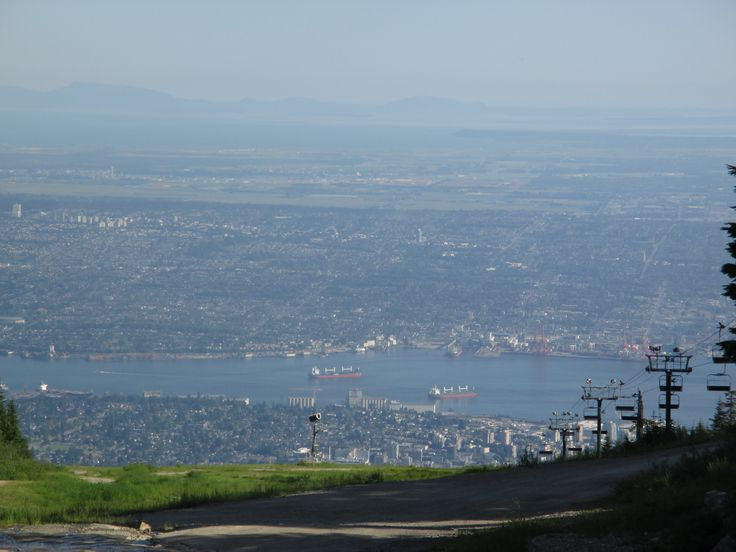 Looking down Downtown, Vancouver from Upper Grouse Mountain, North Vancouver, BC, Canada Weather: Sunny Season: Summer