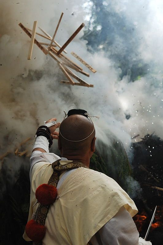Yamabushi (Japanese mountain ascetic hermits) performing a ritual of making offerings into consecrated fire. 採燈大護摩
