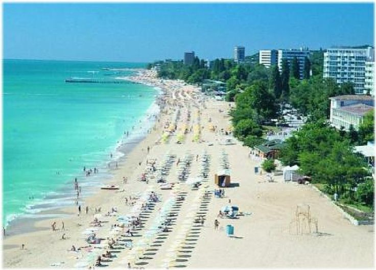 Varna, Bulgaria is crazy cheap and the beach (Black Sea) is gorgeous.