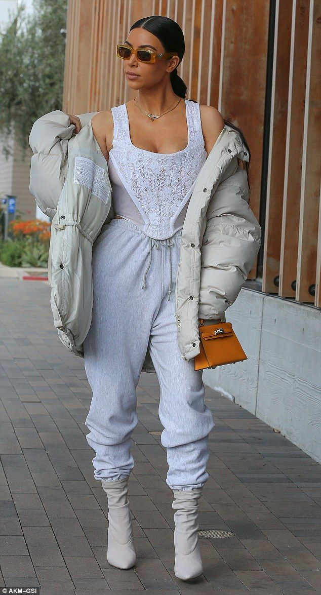 Kim Kardashian sports skimpy corset top with lace detailing and sweats #dailymail
