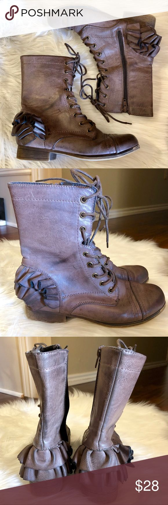 Betsey Johnson Ruffled Combat Boots Boho Size 7 Betsey Johnson Ruffle Trimmed Combat Boots   Size 7   Good pre-owned condition, a few minor imperfections including one small scratch on inward facing panel, pictured.   Distressed finish. These are a mocha color; they are brown with a greyish hue.   Thank you for looking! Betsey Johnson Shoes Combat & Moto Boots