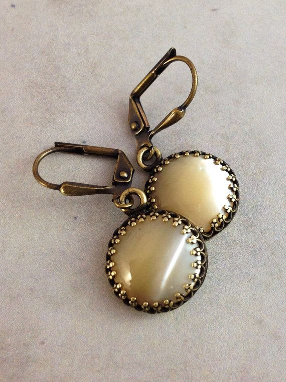 Mother of pearl earrings. Antique brass jewelry. Cream pearl drops on classic leverback ear wires.