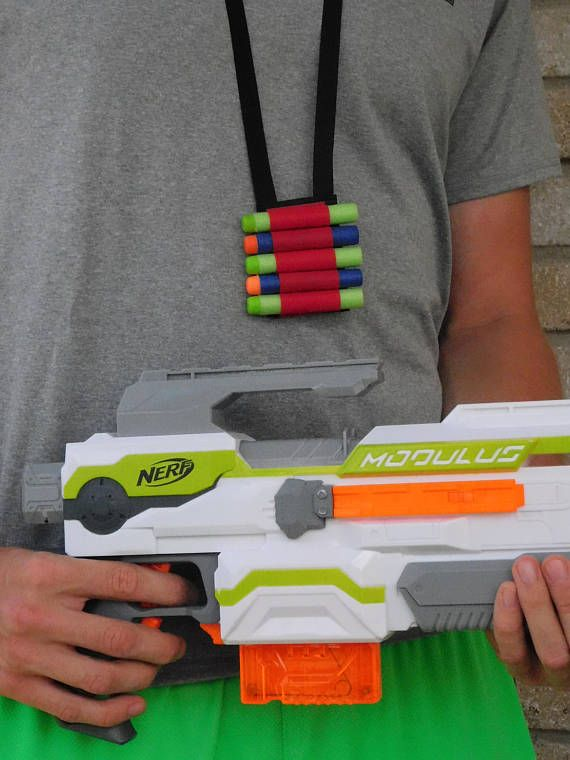 Nerf gun accessory- lanyard to hold foam dart ammunition bullets- one size fits all  These are great for Nerf wars, birthday party favors, and prizes to give away at any type of event or family get together.  Completely customize-able to your fabric color, size, and length! Just message me through Etsy and I will be happy to meet your specific needs or add a note to seller at check-out.  This is a durable, light weight, man made fabric with great color choices. Available in black, brown…