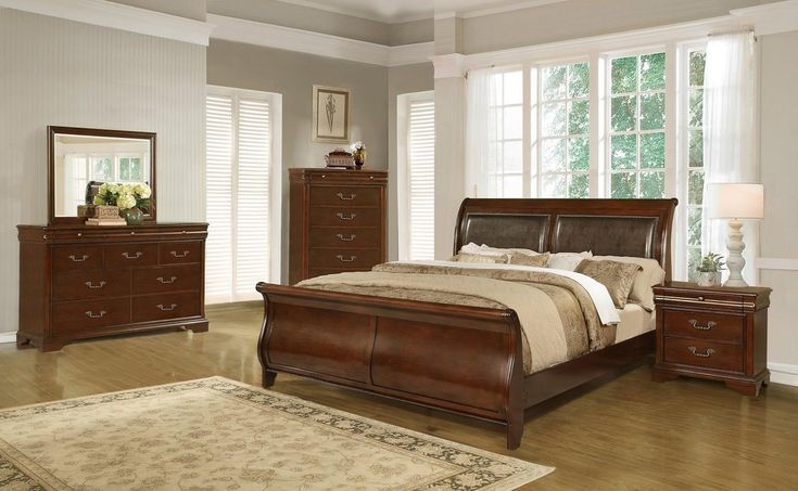 King Sleigh Bedroom Set | Unclaimed Freight Co. | Lancaster, PA | King Sleigh Bedroom Set  Create a master suite you can be proud of with this traditional King Sleigh Bedroom Set. Each piece in this group is expertly crafted from select veneers and solids and has been bathed in a rich cherry finish for a timeless feel. The bed with its rich brown upholstered headboard, nailhead trim and sleigh silhouettes gives your bedroom a traditional yet modern look.