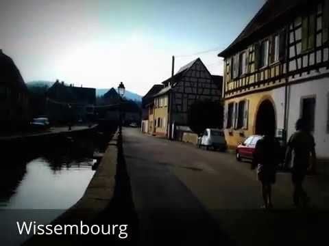 """Places to see in ( Wissembourg - France )  Wissembourg is a commune in the Bas-Rhin department in Grand Est in northeastern France. Wissembourg is situated on the little River Lauter close to the border between France and Germany approximately 60 km north of Strasbourg and 35 km west of Karlsruhe. Wissembourg is a sub-prefecture of the department. The name Wissembourg is a Gallicized version of Weißenburg (Weissenburg) in German meaning """"white castle"""".  Weissenburg (later Wissembourg) Abbey…"""