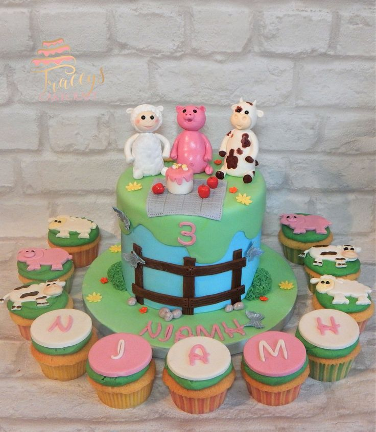 Farm animal picnic cake with matching cupcakes