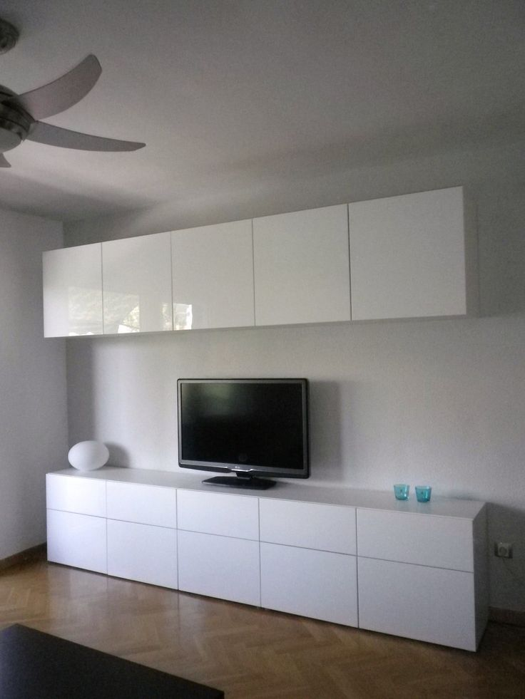 cabinets above & below TV