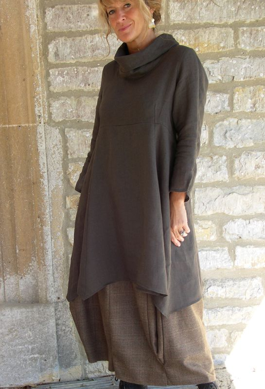 Roll Collar Tunic £215, over Bubble skirt in wool £245.