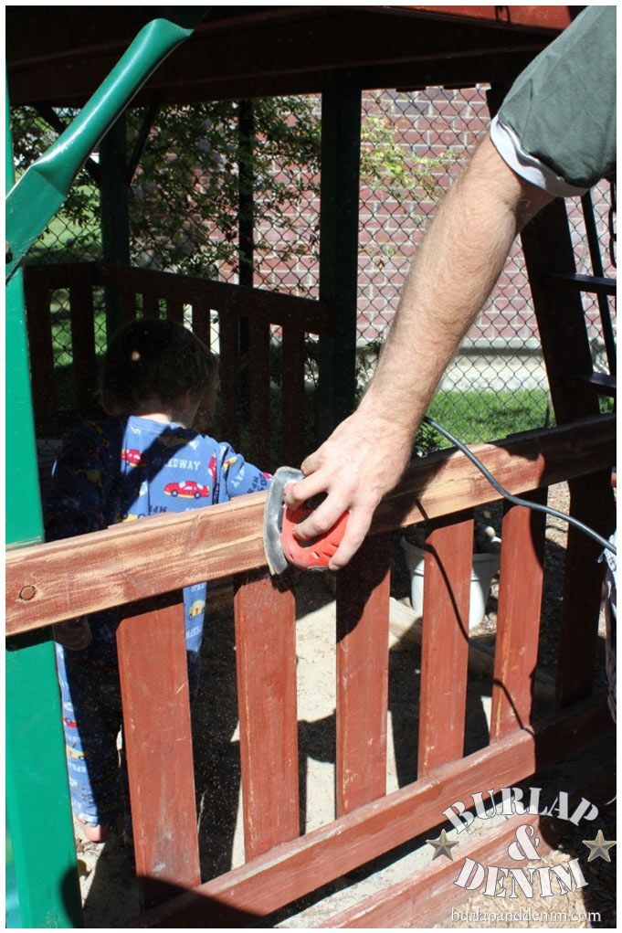 Sand the entire wood swing set with an electric sander
