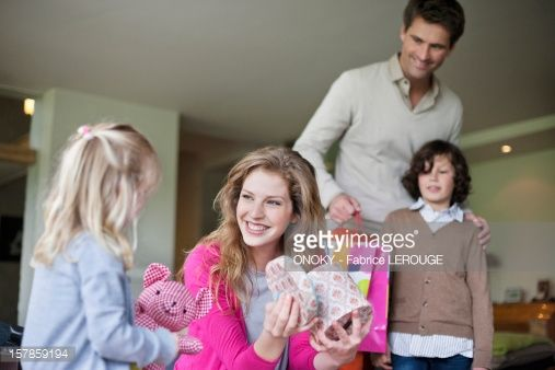 Stock Photo : Girl giving surprise gift to her mother on mother day
