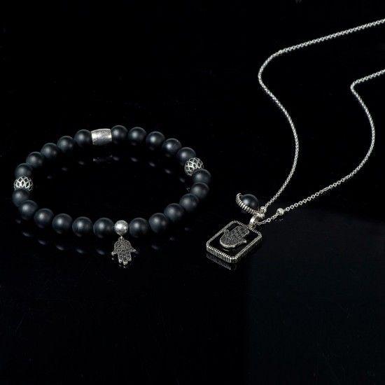 Bracelet et collier PROTECTION. La Main Hamsa : protège et défend contre le mauvais œil. Pierre : Onyx noire. Fortifie la confiance en soi et le sens des responsabilités. Vous aide à adopter un mode de vie plus stable et sain.