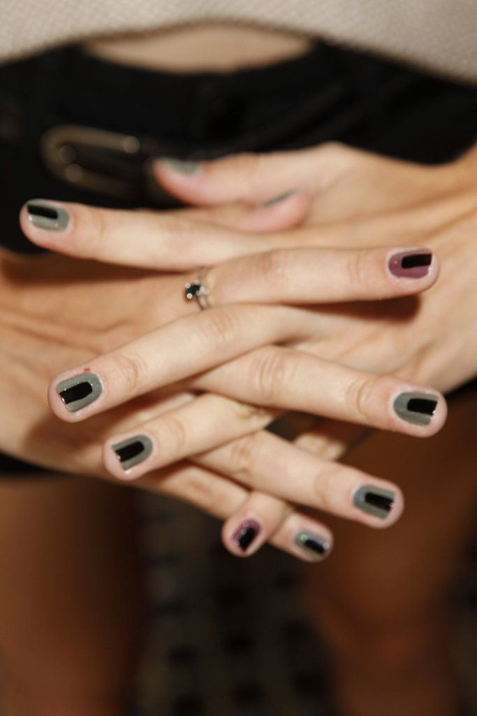 THE TOP GLOBAL MANICURES FOR SPRING 2013: Nails were alternated with mauve (Toff) and olive (Sloane Ranger). Then a stripe of black polish was placed in the center of the nail. Finally, Butter London manicurists then used a Knackered top coat to give a holographic effect.    Photo courtesy of Butter London