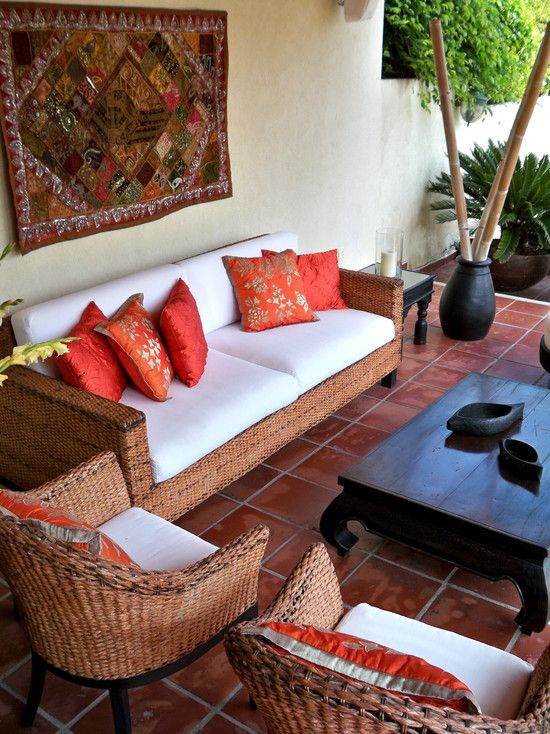 patio-decoration-ideas-bamboo-poles-sofa-terracotta-tiles