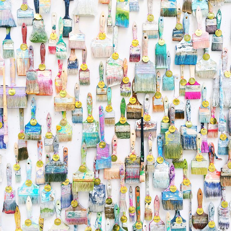 Paint brush wall! Looking for a creative and inspiring design for an office, house or gallery wall, then this graphic, colourful and unique style idea is for you! It's simply hanging old paint brushes! So simple and creative.