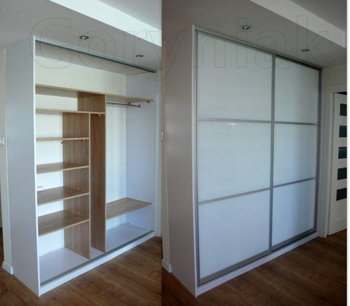wnętrze szafy wykonane z płyty dąb obudowa biała - drzwi Bonari profil Monaco zajmujący zaledwie 5.5cm z gł. zabudowy - więcej zdjęć naszych prac na www.Goryniak.pl