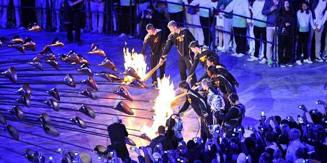 British Olympic rower Steve Redgrave carried the torch into the stadium, before handing it over to seven budding young athletes who ignited copper petals around the cauldron.     Read more: http://www.metro.co.uk/olympics/906568-young-british-athletes-light-cauldron-at-olympics-opening-ceremony#ixzz21xIUcVrL