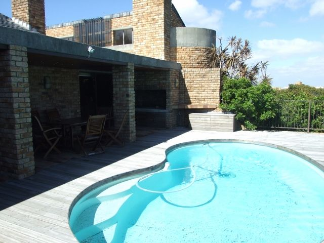 Outside braai area with a swimming pool on the deck - amazing views