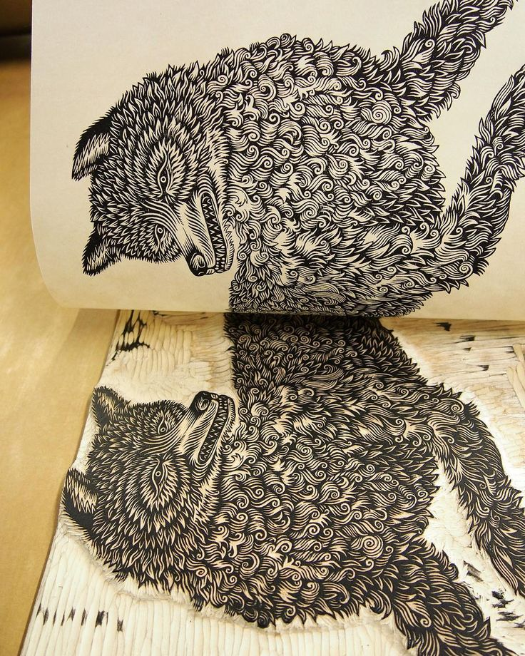 "Mirror image: ""THE WOLF"" woodcut looks at ""THE WOLF"" woodblock - on press earlier this year #tbt; limited edition of hand-pulled prints available in the T.B.P.S. shop & Etsy #woodcut #woodcarving #printing #tugboatprintshop #valerielueth #thewolf #wolfprint #printmaking #woodcutprocess"
