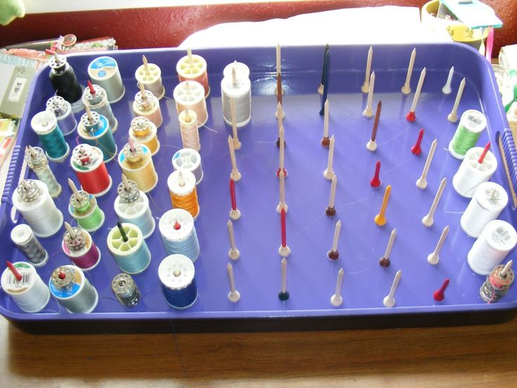 Make a thread storage container with super glue and golf tees