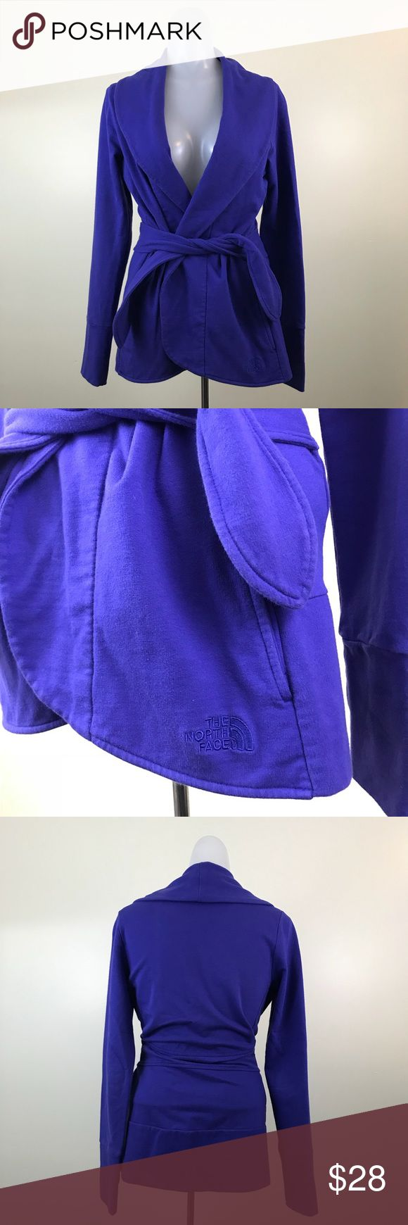 The North Face Tie Waist Cardigan • The North Face cardigan sweater • Ties around waist for a comfortable fit • Minor pilling but nothing too bad • Solid royal blue color • Long sleeves • Size S The North Face Sweaters Cardigans