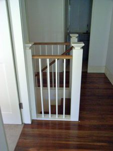 timber handrail with painted posts and balusters