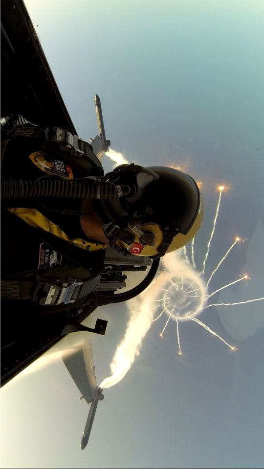 Taken from the Solo Türk, the F-16 solo aerobatics display team of the Turkish Air Force during a display in Girne, Kyrenia, Cyprus. While diving and turning, the pilot released flares, high-temperature heat sources used to mislead surface-to-air or air-to-air missile's heat-seeking targeting systems, creating the pyrotechnic visual effect you can see behind the plane.