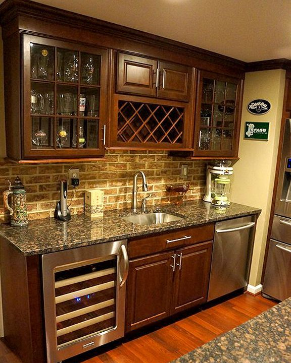 Nice wall unit in place of a bar area in a finished basement or media room. www.organizedhomeremodeling.com backsplash and cabinets