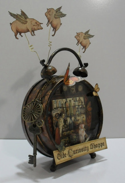 Cassie's Scraps: Olde Curiosity Shoppe Altered Clock (@Anna Totten Nadal 45®)  Note:  the blog this links to no longer exists, but the piece was so great I had to share it.