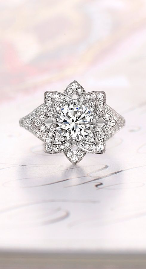 A true show-stopper, our Lily engagement ring has an ornate diamond-encrusted floral design. Explore our collection of unique diamond engagement rings!