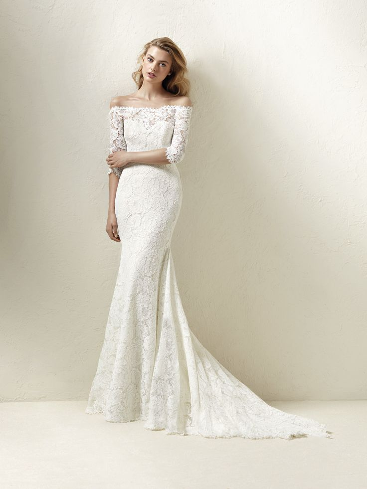 This dress is romance personified with its magnificent mermaid design, off-the-shoulder neckline and French sleeves. A dress made completely from lace, that plays with transparencies and streamlines…